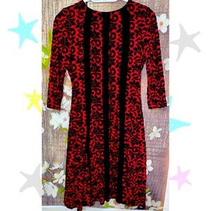 Dressbarn red and black for and flare with figure flattering details
